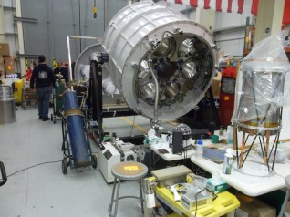 Looking from insert land into the larger high bay. You can see the bottom of the cryostat into which six telescopes are inserted.