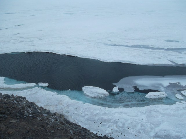 A big opening in the sea ice where you could see the crystal clear ocean underneath.