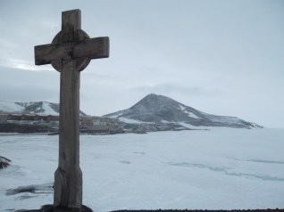 Vince's Cross at Hut Point, with Ob Hill and town in the background.