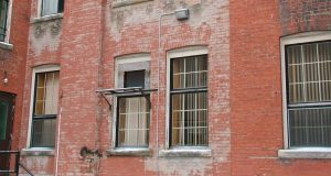 Res brick building with large windows.