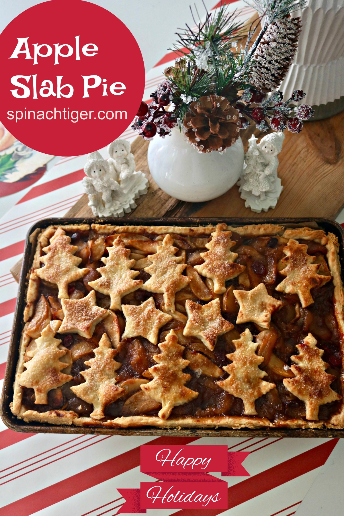 Make a sheet pan slab apple cranberry  pie for a crowd with old fashioned flavors. Cinnamon, Orange, Vanilla, Cardamom. Learn exactly how much dough to make. #applepie #slabpie #appleslabpie #stovetopapplefilling #Christmaspie #spinachtiger via @angelaroberts