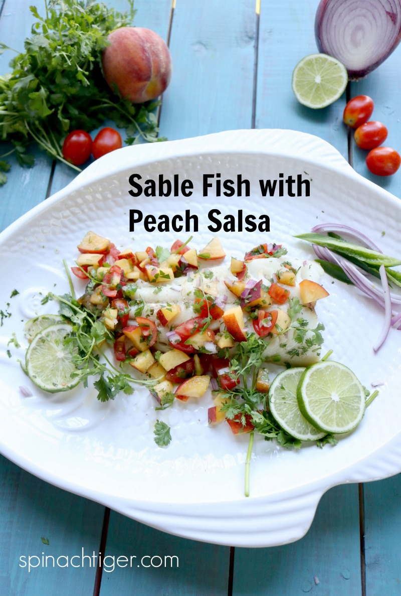 Wild Alaskan Roasted Sable Fish with Fresh Peach Salsa from Sitka Salmon Shares. Peaches cut through this buttery, delicate mild tasting fish for a clean, healthy decadent meal. #sablefish #roastedfish #peaches #peachsalsa #spinachtiger #sitkasalmnshares. via @angelaroberts