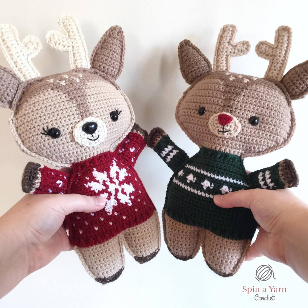 Reindeer wearing red and green sweaters