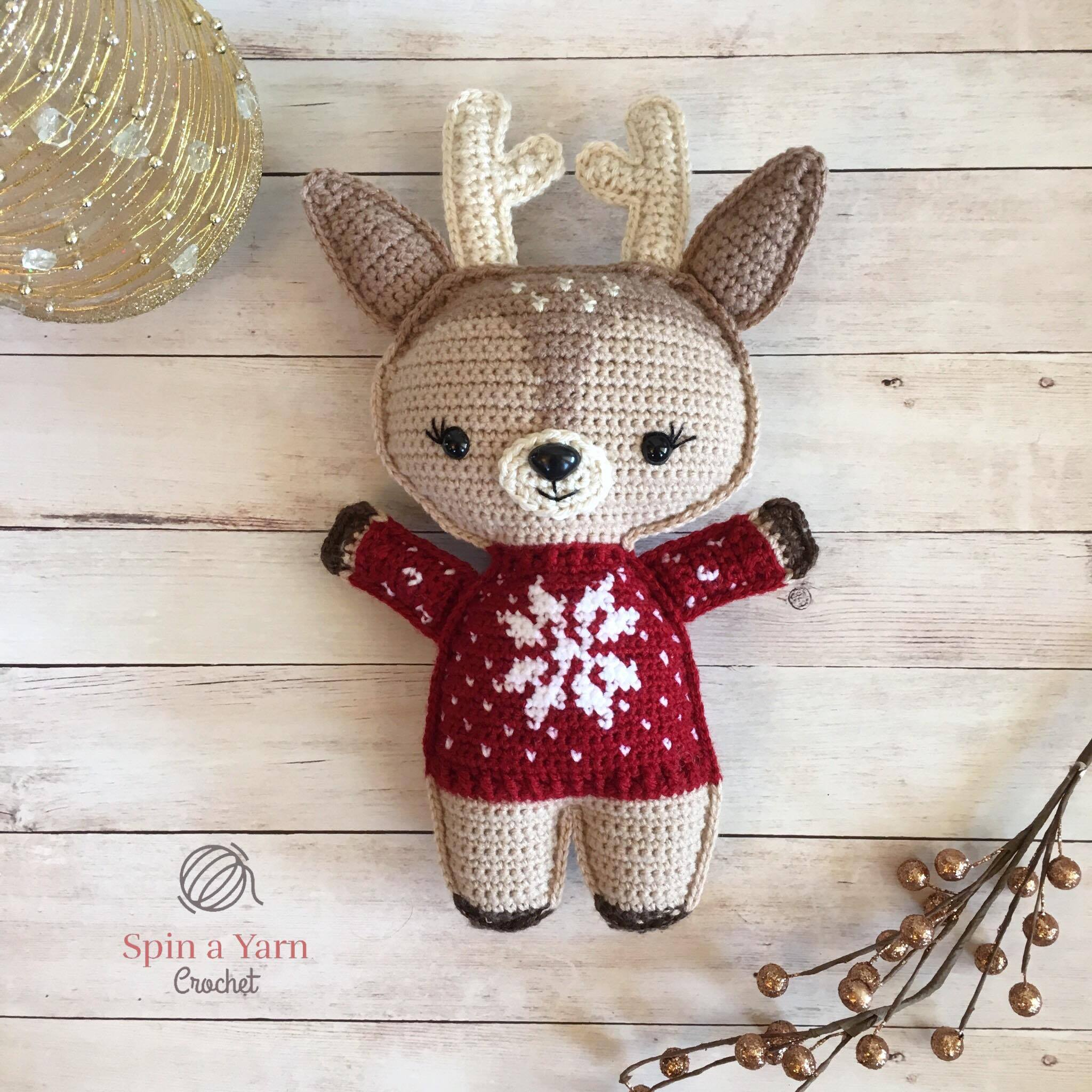 Reindeer wearing red sweater with gold