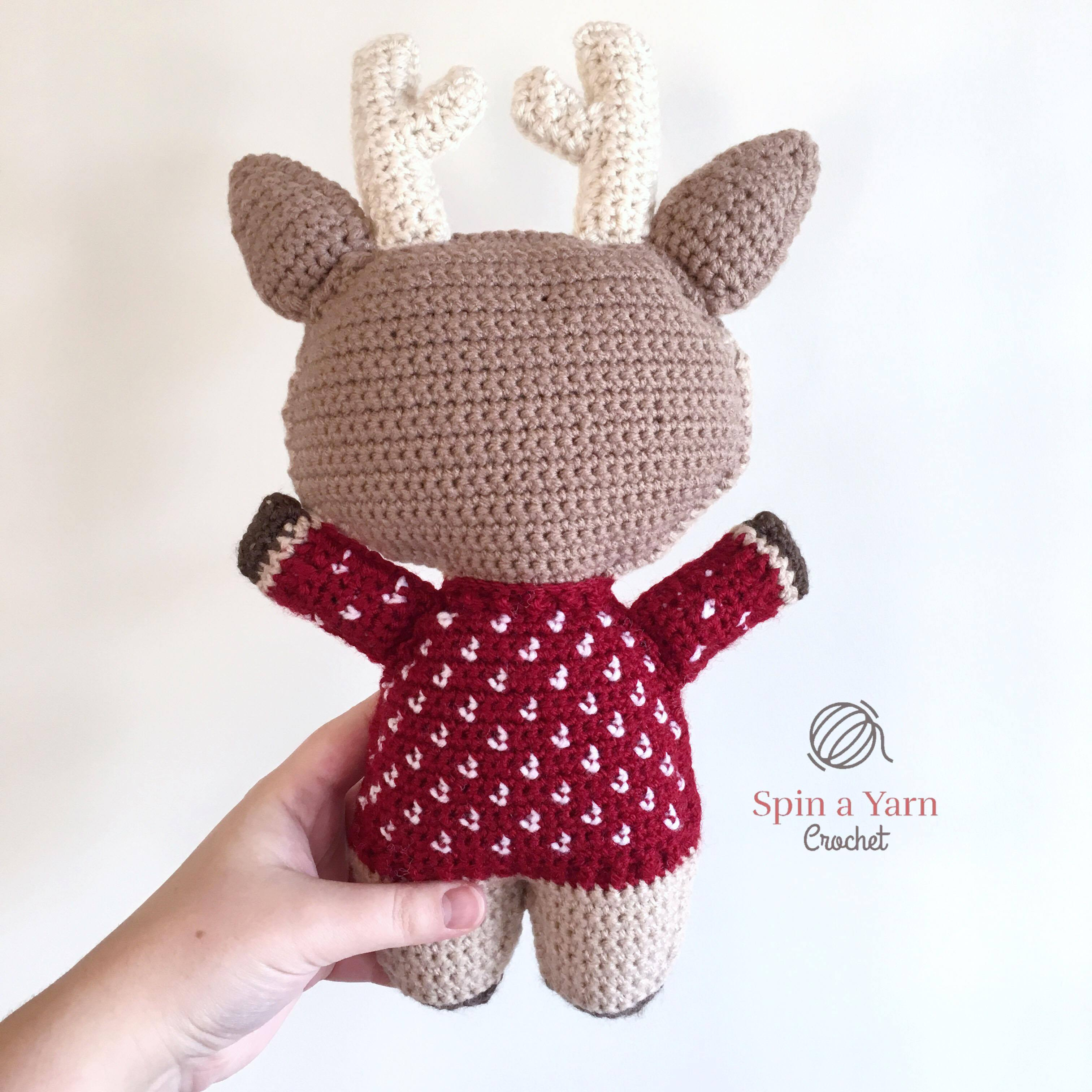 Back view of reindeer in red sweater
