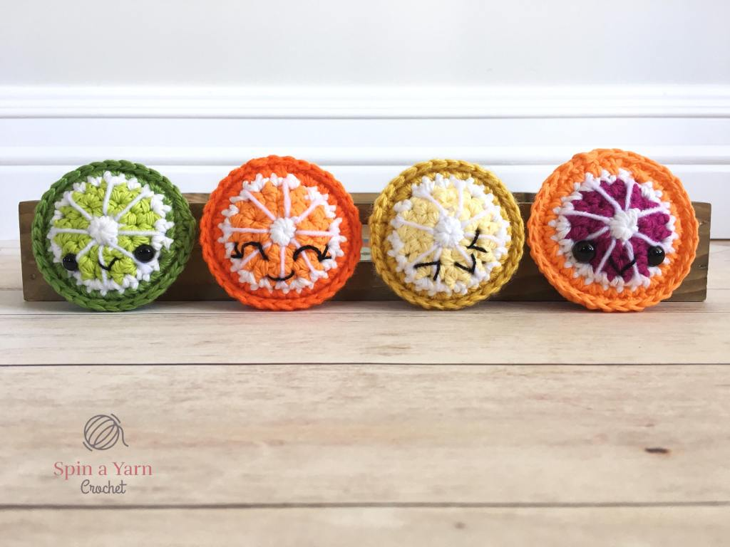 Four citrus fruit slices in a row
