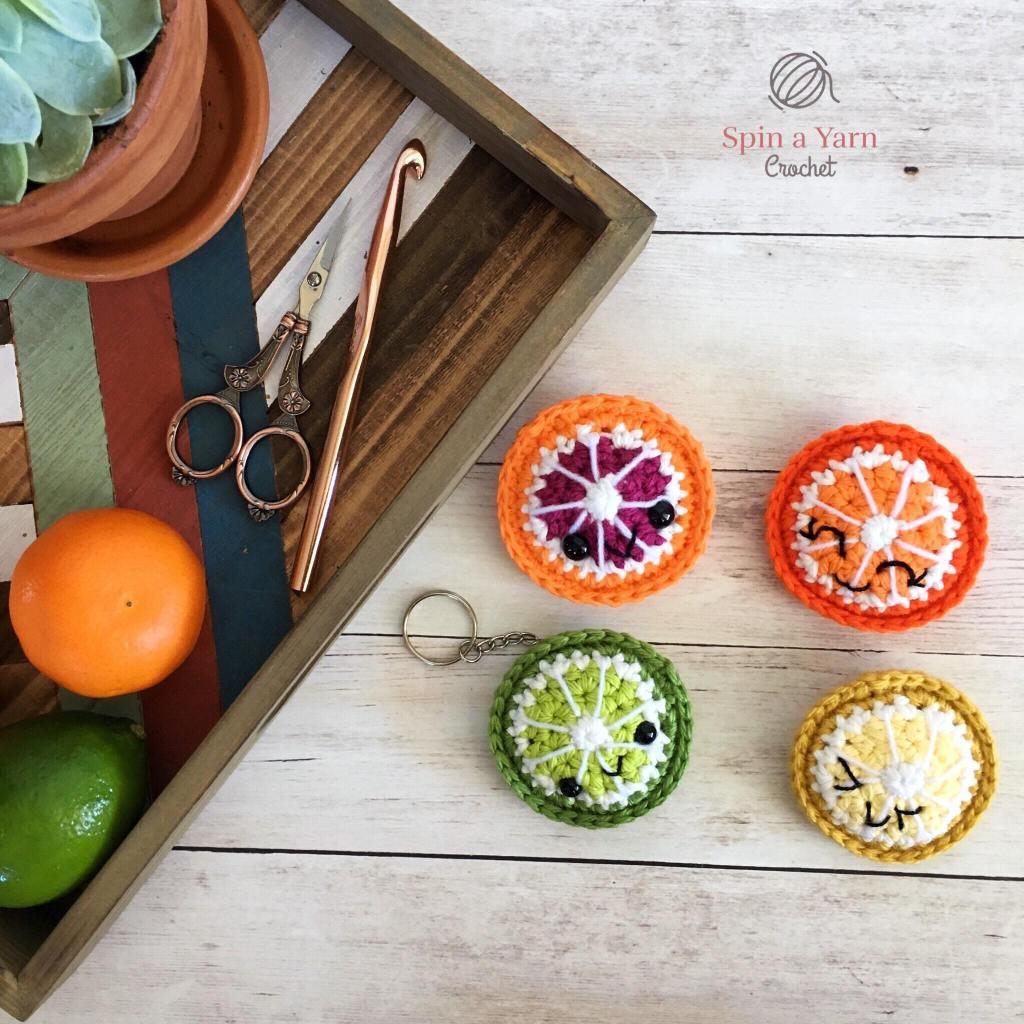 Four citrus fruit slices next to tray