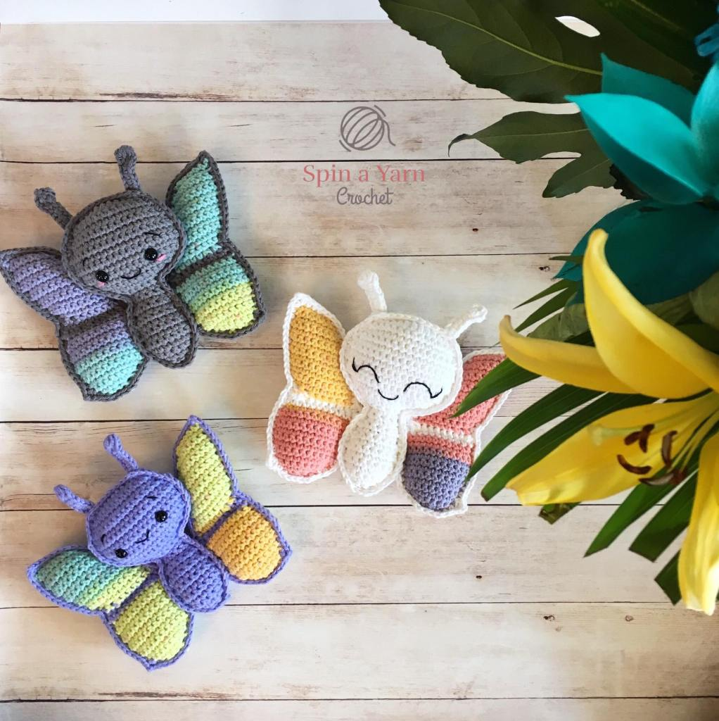 Three crocheted butterflies with flowers