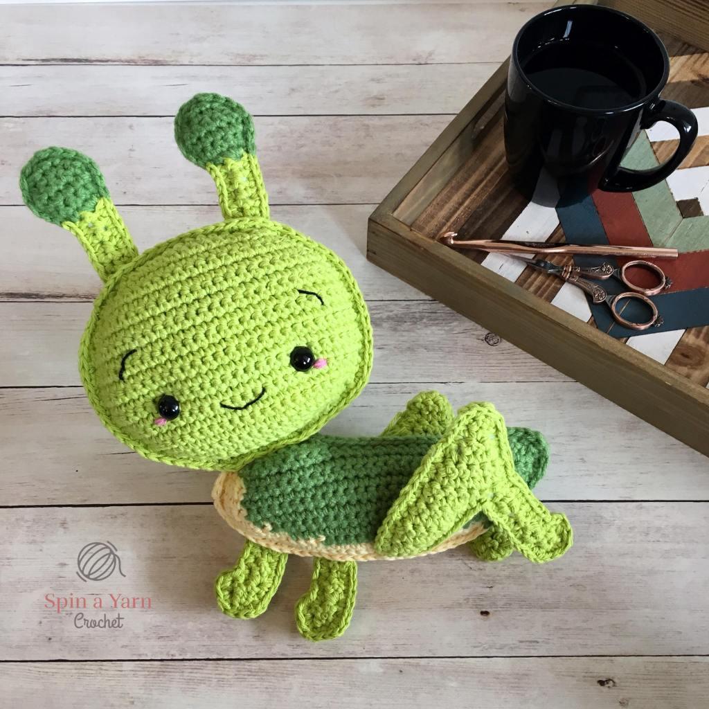 Completed crochet grasshopper