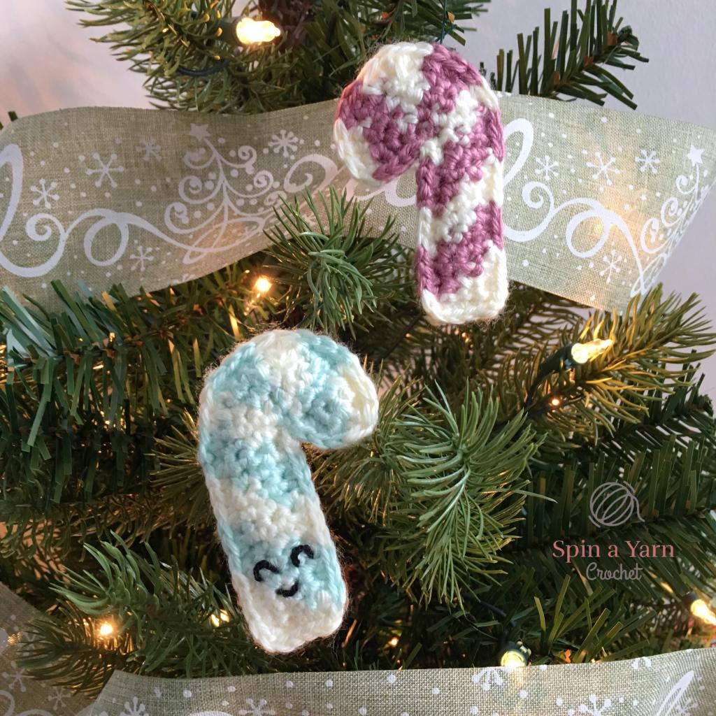 Mint and plum crochet candy canes on tree