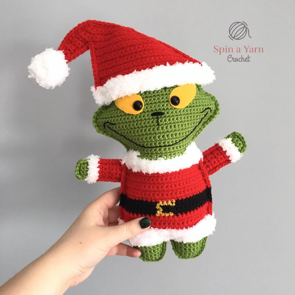 hand holding grinch