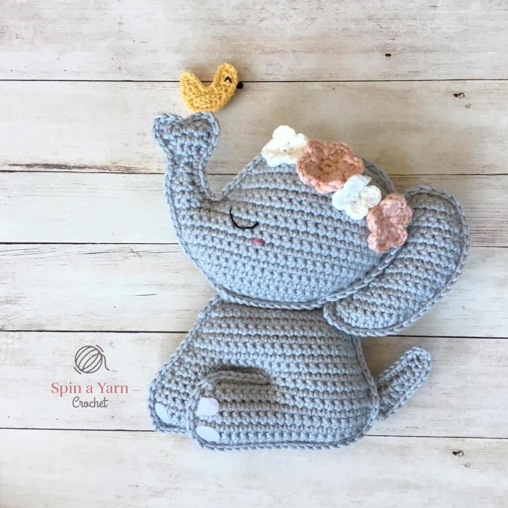 Crocheted elephant with bird