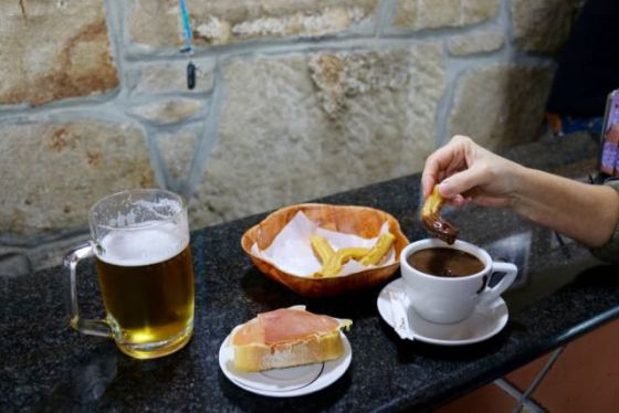 chocolate con churros (with someone's beer and jamón in the photo)