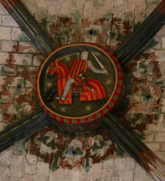 painting in the keystone of one of the arches