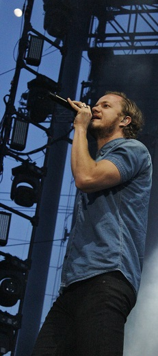 I got better photos, but... I caught the moon in this one with Dan Reynolds.