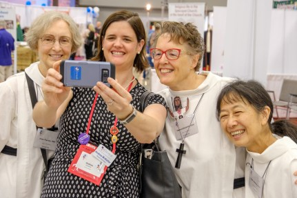 Andrea McKellar of Former takes a selfie on The Order of Saint Helena stand. L-R: Ellen Francis, Andrea McKellar, Miriam Elizabeth, and Faith Anthony Image: Gary Allman