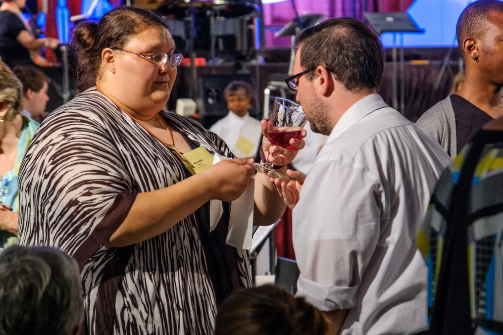Meredith Seaton serving communion wine at the General Convention Closing Eucharist. Image: Gary Allman