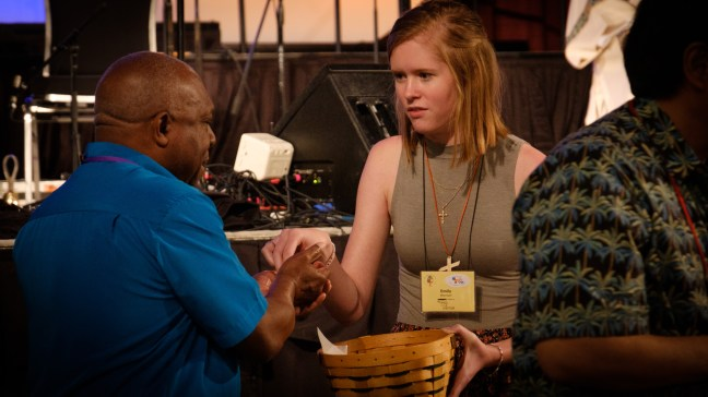 Emily Morrison serving communion bread at the General Convention Closing Eucharist. Image: Gary Allman