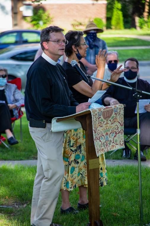 Prayer for Racial Justice - The Rev. John Spicer, St. Andrew's, Kansas City, Missouri reads Galatians 3:28. Image credit: Mary Ann Teschan