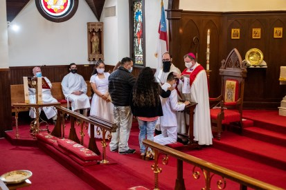 A candidate from St. Nicholas Episcopal Church, Noel, is confirmed. Image credit: Gary Allman