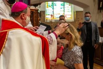 A candidate from the Episcopal Church of the Redeemer, Kansas City. Area Confirmations, St. Andrew's Episcopal Church, Kansas City. Image credit: Mary Ann Teschan