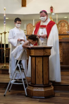 """""""...I baptize you in the Name of the Father, and of the Son, and of the Holy Spirit..."""" Baptisms at St. James Episcopal Church, Springfield, Missouri. Image credit: Gary Allman"""