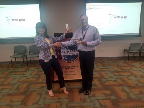 "Joann awarding Asad the weekly ""Most Improved Speaker"" award"