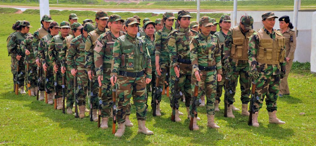 Female Peshmerga fighters line up in formation at their training camp in northern Iraq