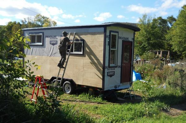 Sky works on the tiny house, summer 2012.
