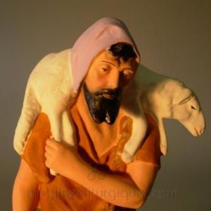 berger-portant-un-mouton-sur-ses-epaules-p-image-23825-grande