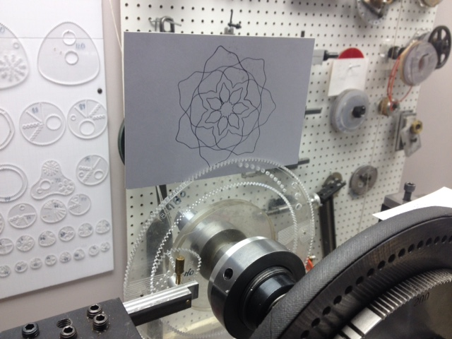Rose engine with wild gears and design on paper.