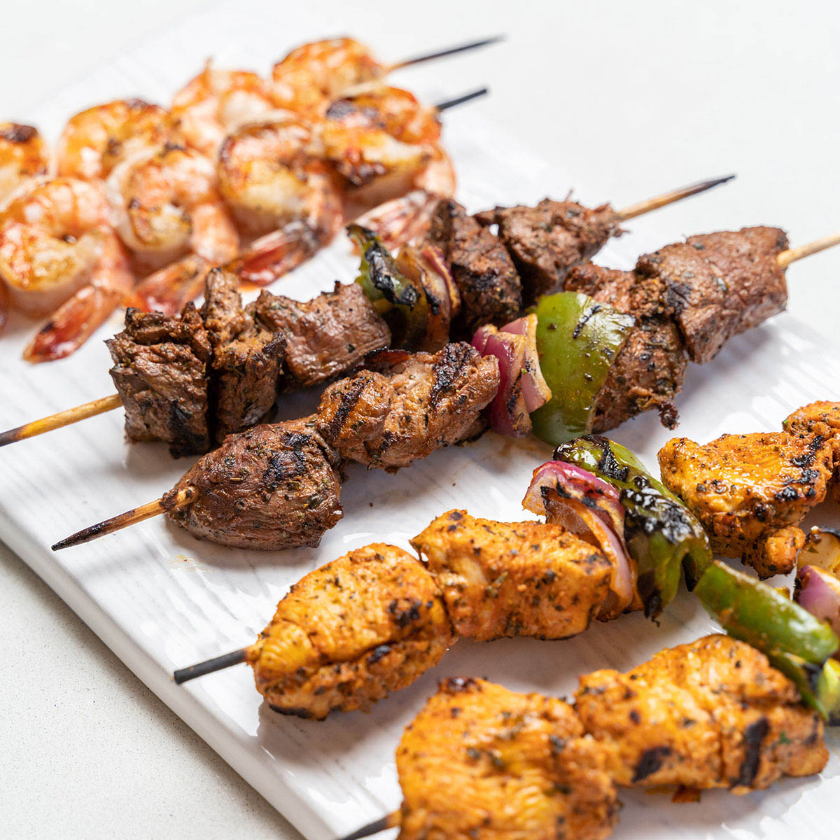 keto catering heathy meat and fish kabobs