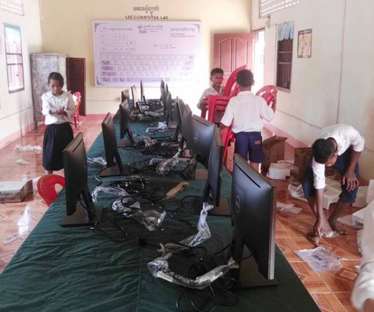 students unpacking computers