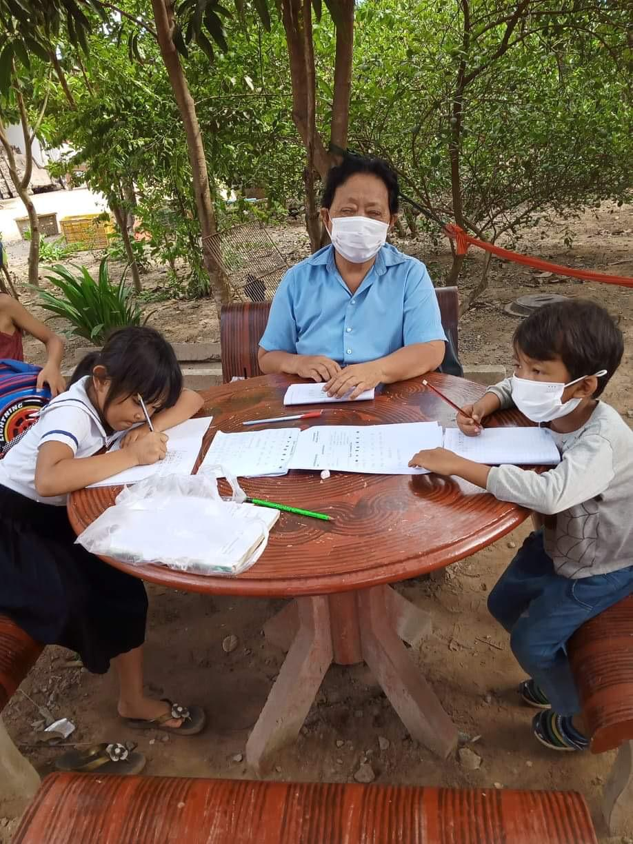 Masked teacher and students learning