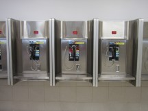"""Case in point: Payphones are so yesterday. Those yellow stickers blocking the coin slots say """"Phone Service Discontinued"""" because everyone has a phone in his or her pocket nowadays."""
