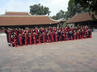 class photo for some local university graduates