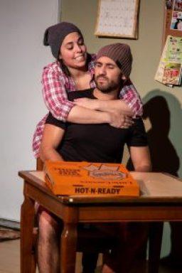 A woman hugs a man