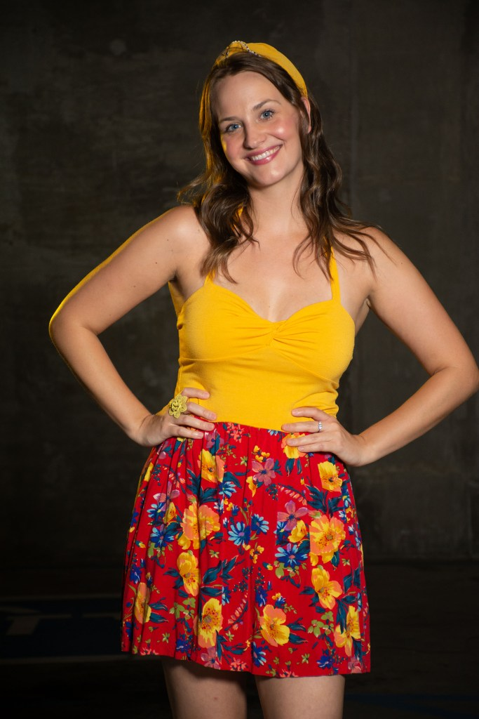 Woman in a yellow and red sundress