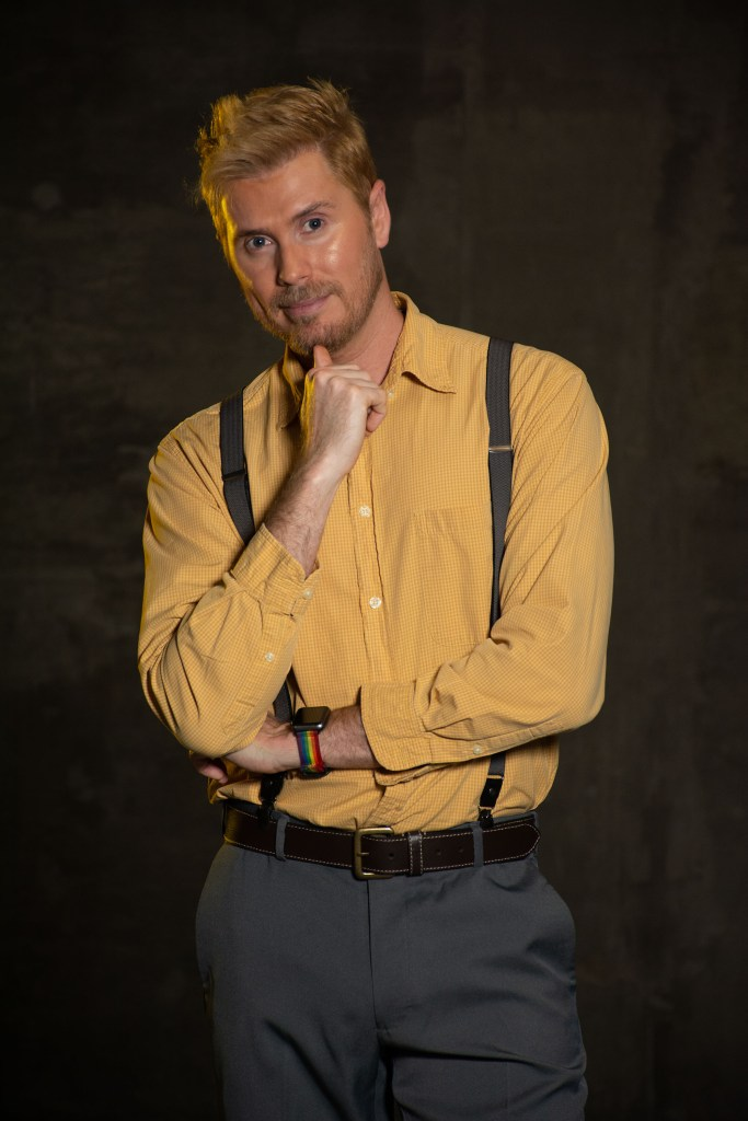 Man in a yellow button down and suspenders