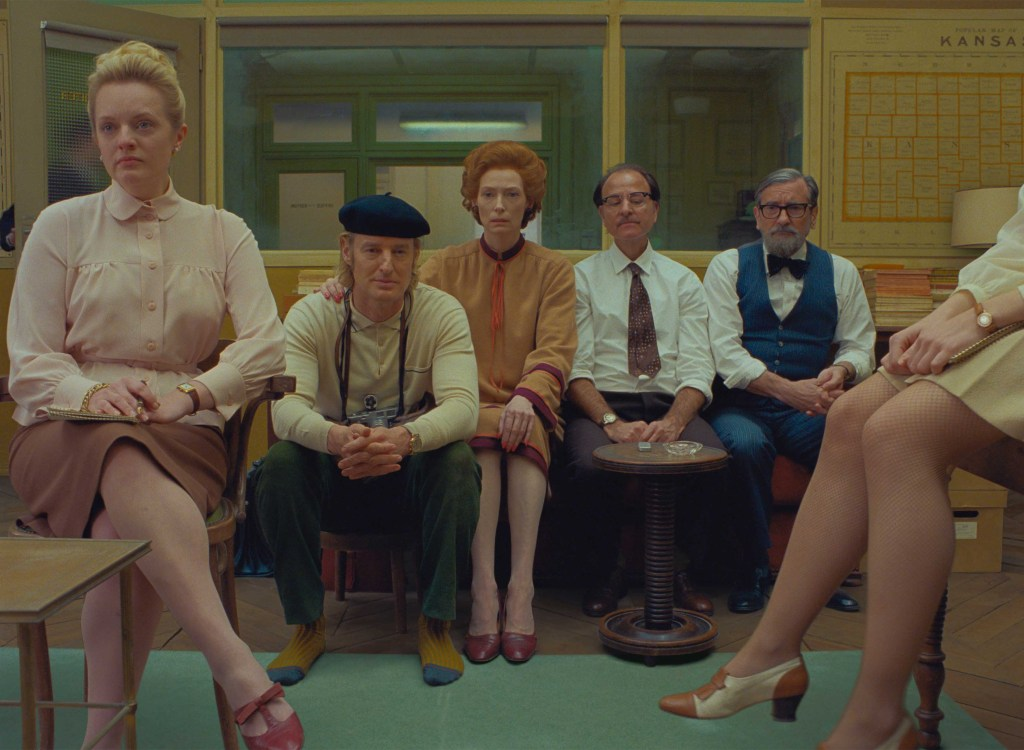 (From L-R): Elisabeth Moss, Owen Wilson, Tilda Swinton, Fisher Stevens and Griffin Dunne in the film THE FRENCH DISPATCH. Photo Courtesy of  Searchlight Pictures. © 2020 Twentieth Century Fox Film Corporation.