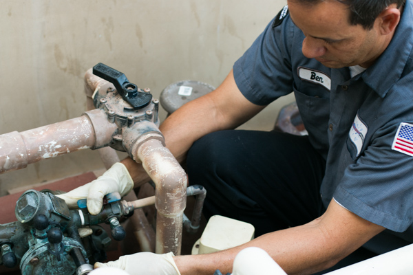 Ben performs backflow testing in Orange County