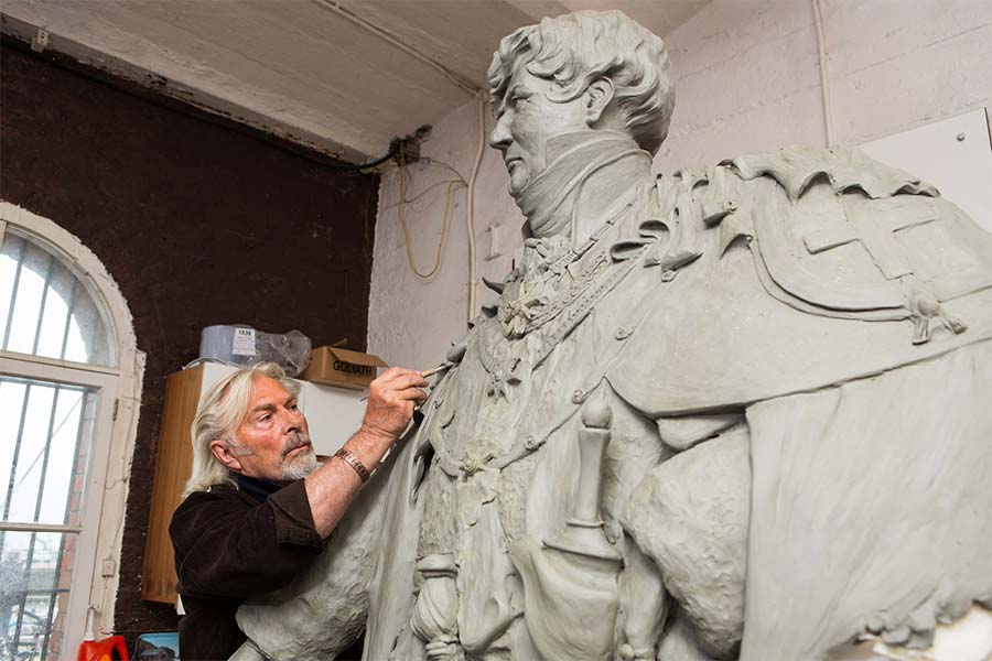 Dominic Grant working in his Ramsgate harbour studio on King George IV statue