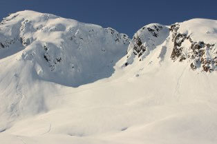 Laying fresh tracks on our last day to the top of a zone we called The Boneyard. Neil broke his arm on the way down.