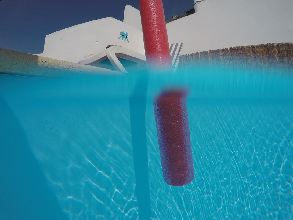 split-photo-normal-gopro-housing-blurred-waterline-and-refraction