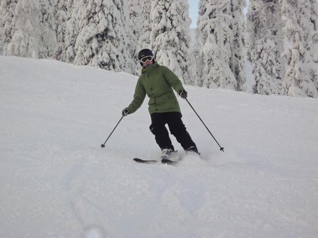 Wearing the Honee Snugs Coat while Skiing