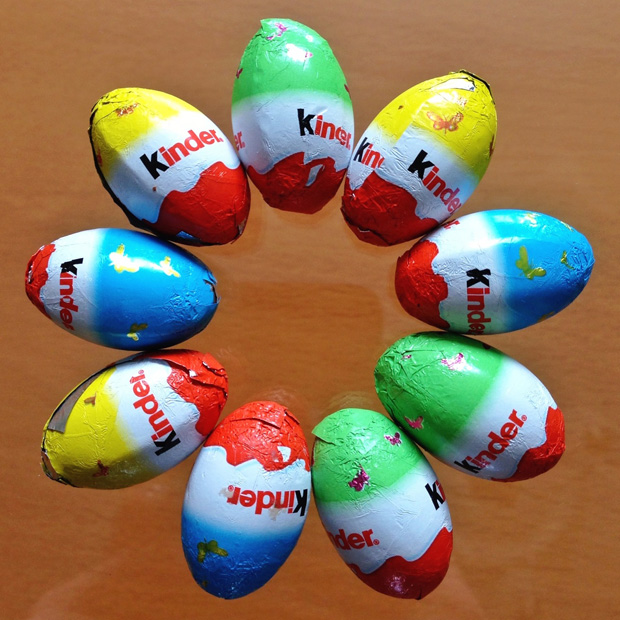 Kinder Eggs on a Glass Table Top