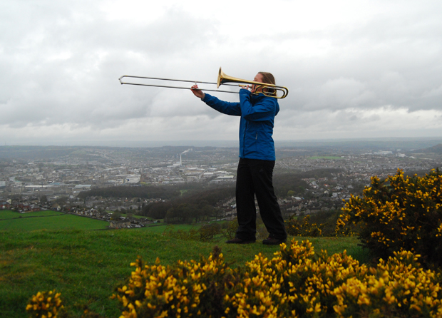 """""""Extreme Tromboning"""" on Castle Hill, overlooking Huddersfield"""