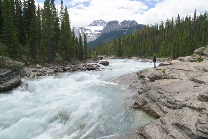Standing by the river along the Icefields Parkway