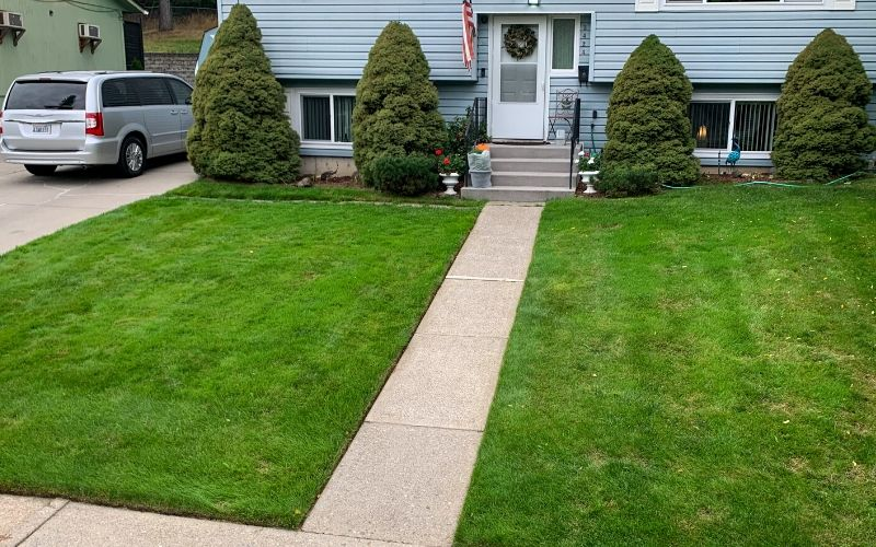 A residential Spokane home with a freshly mowed lawn. The edges of the lawn have been edged.
