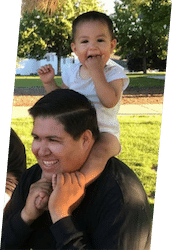 Jose, the owner of Spokane's Finest Lawns, with his daughter.